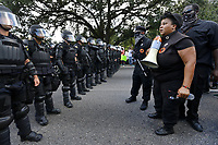 Armed members of the New Black Panther Party confront law enforcement officers during a demonstration protesting the shooting death of Alton Sterling near the headquarters of the Baton Rouge Police Department in Baton Rouge, Louisiana, U.S. July 9, 2016.