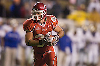 23 December 2006: Utah player Eric Weddle rushes for the Ute's last touchdown during the 2006 Bell Helicopters Armed Forces Bowl between The University of Tulsa and The University of Utah at Amon G. Carter Stadium in Fort Worth, TX.