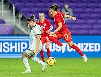ORLANDO, FL - FEBRUARY 21: Jessie Fleming #17 of Canada has her shot blocked during a game between Canada and Argentina at Exploria Stadium on February 21, 2021 in Orlando, Florida.