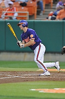 Clemson Tigers catcher Garrett Boulware #30 swings at a pitch during a game against the Florida State Seminoles at Doug Kingsmore Stadium on March 22, 2014 in Clemson, South Carolina. The Seminoles defeated the Tigers 4-3. (Tony Farlow/Four Seam Images)