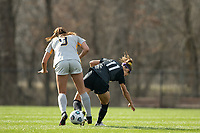 LOUISVILLE, KY - MARCH 13: Emily Fox #11 of Racing Louisville FC and Lauren Segalla #9 of West Virginia University battle for the ball during a game between West Virginia University and Racing Louisville FC at Thurman Hutchins Park on March 13, 2021 in Louisville, Kentucky.
