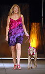 Linda Riehl with Luder at the Citizens for Animal Protection owner/pet fashion show at the Hilton Americas Houston Saturday June 06,2009.(Dave Rossman/For the Chronicle)