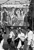 milano, l'enorme cartellone pubblicitario di armani in via broletto in centro con l'immagine della modella milla jovovich --- milan, the huge armani advertising in broletto street in downtown with the image of the model milla jovovich