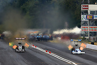 Aug. 3, 2013; Kent, WA, USA: NHRA top fuel dragster driver T.J. Zizzo (right) races alongside Terry McMillen during qualifying for the Northwest Nationals at Pacific Raceways. Mandatory Credit: Mark J. Rebilas-USA TODAY Sports