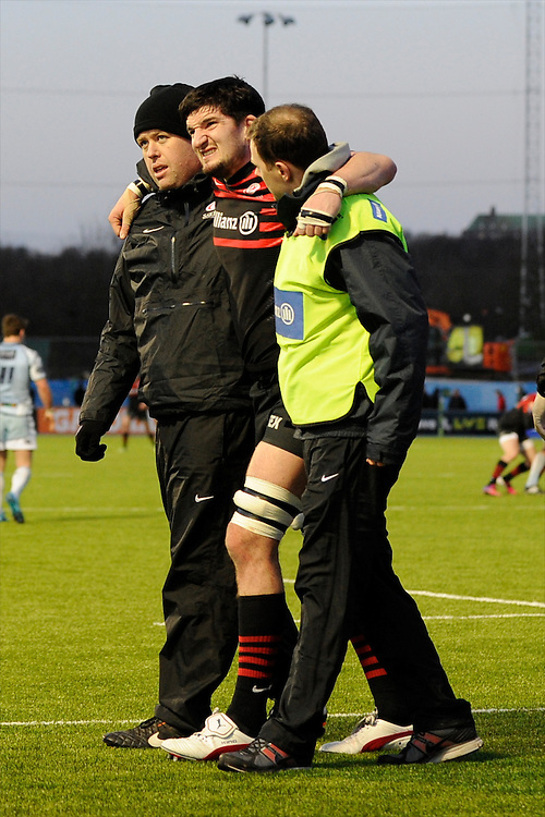 20130127 Copyright onEdition 2013©.Free for editorial use image, please credit: onEdition..Eoin Sheriff of Saracens is helped off the pitch with an injury during the LV= Cup match between Saracens and Cardiff Blues at Allianz Park on Sunday 27th January 2013 (Photo by Rob Munro)..For press contacts contact: Sam Feasey at brandRapport on M: +44 (0)7717 757114 E: SFeasey@brand-rapport.com..If you require a higher resolution image or you have any other onEdition photographic enquiries, please contact onEdition on 0845 900 2 900 or email info@onEdition.com.This image is copyright onEdition 2013©..This image has been supplied by onEdition and must be credited onEdition. The author is asserting his full Moral rights in relation to the publication of this image. Rights for onward transmission of any image or file is not granted or implied. Changing or deleting Copyright information is illegal as specified in the Copyright, Design and Patents Act 1988. If you are in any way unsure of your right to publish this image please contact onEdition on 0845 900 2 900 or email info@onEdition.com