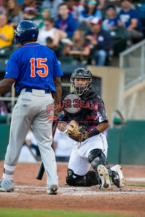 Northwest Arkansas Naturals catcher Meibrys Viloria (22) looks to the dugout as Dairon Blanco (15) steps to the plate on May 4, 2019, at Arvest Ballpark in Springdale, Arkansas. (Jason Ivester/Four Seam Images)