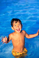 Young boy playing in the pool