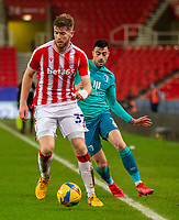 2nd January 2021; Bet365 Stadium, Stoke, Staffordshire, England; English Football League Championship Football, Stoke City versus Bournemouth; Nathan Collins of Stoke City under pressure from Diego Rico of Bournemouth