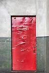 Fire Door.  Red Door. Seattle, WA, Georgetown Steam Plant, a National Historic Landmark in Seattle, WA USA