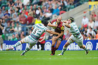 Charlie Hodgson of Saracens is tackled by Bryn Evans (left) and Kieran Low of London Irish during the Aviva Premiership match between Saracens and London Irish at Twickenham on Saturday 1st September 2012 (Photo by Rob Munro)