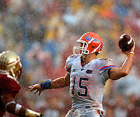 Florida quarterback #15 Tim Tebow (right) throws a 7 yard touchdown pass in a driving rain to give the Gators a 14-3 lead over Florida State at Doak Campbell Stadium in Tallahassee, Fl.
