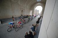peloton riding through the Menenpoort war memorial<br /> <br /> Gent-Wevelgem 2014