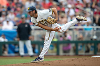 Michigan Wolverines pitcher Karl Kauffmann (37) follows through on his delivery during Game 1 of the NCAA College World Series against the Texas Tech Red Raiders on June 15, 2019 at TD Ameritrade Park in Omaha, Nebraska. Michigan defeated Texas Tech 5-3. (Andrew Woolley/Four Seam Images)