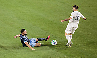 CARSON, CA - MARCH 07: Lucas Cavallini #9 of the Vancouver Whitecaps slide tackles Emiliano Insua #3 of the Los Angeles Galaxy during a game between Vancouver Whitecaps and Los Angeles Galaxy at Dignity Health Sports Park on March 07, 2020 in Carson, California.