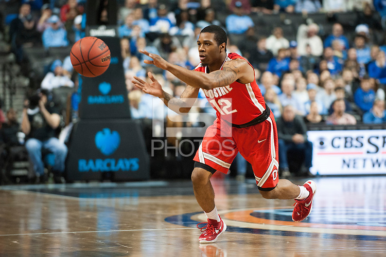 BROOKLYN, NY - Saturday December 19, 2015: A.J. Harris (#12) of Ohio State makes a pass against Kentucky as the two teams square off in the CBS Classic at Barclays Center in Brooklyn, NY.