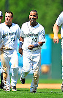 15 July 2010: Vermont Lake Monsters' infielder Hendry Jimenez smiles in celebration after a game against the Aberdeen IronBirds at Centennial Field in Burlington, Vermont. The Lake Monsters rallied in the bottom of the 9th inning to defeat the IronBirds 7-6 notching their league leading 20th win of the 2010 NY Penn League season. Mandatory Credit: Ed Wolfstein Photo