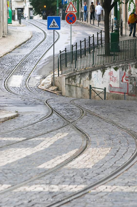 Tram tracks. At Miradouro de Santa Luzia. Street view. Alfama district. Lisbon, Portugal