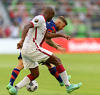 AUSTIN, TX - JULY 29: Paul Arriola #7 of the United States attempts to steal the ball from  Abdelkarim Hassan #3 of Qatar during a game between Qatar and USMNT at Q2 Stadium on July 29, 2021 in Austin, Texas.