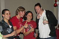 6 April 2008: Former Stanford Cardinal basketball players Jamila Wideman, Vanessa Nygaard, Milena Flores, and Heather Owen during Stanford's pre-game rally/reception for the 2008 NCAA Division I Women's Basketball Final Four semifinal game at the Westin Harbour Island hotel in Tampa, FL.