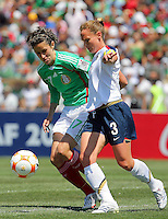 Christie Rampone battles for the ball during the USA vs Mexico's Group A 2008 CONCACAF Olympic Women's Qualifying Tournament  in Ciudad Juarez, Mexico, April 6, 2008.