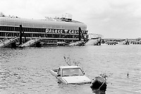 USA. Mississippi. Biloxi. Aftermath of hurricane Katrina. Palace Casino. Due to massive floating  of the tidal surge (water wave), casinos barges are destroyed or hurled hundred of feet away from their anchorage points. A brige is also destroyed. A pick-up car is the water.  © 2005 Didier Ruef