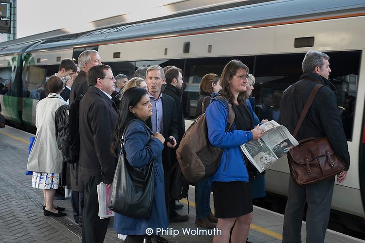 Passengers board a train at London Bridge station