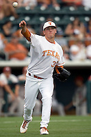 Pitcher Kendal Carrillo #32 of the Texas Longhorns throws the ball to first after a sacrifice bunt against the Oklahoma Sooners in NCAA Big XII baseball on May 1, 2011 at Disch Falk Field in Austin, Texas. (Photo by Andrew Woolley / Four Seam Images)