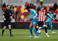22nd May 2021; Brentford Community Stadium, London, England; English Football League Championship Football, Playoff, Brentford FC versus Bournemouth; Mathias Jensen of Brentford challenges Philip Billing of Bournemouth with Referee Jarred Gillett observing the challenge