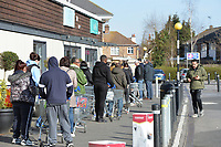 Queues building up outside the Tesco store in Waltham Abbey during the COVID-19 pandemic on 22nd March 2020