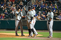 Norfolk Tides Dariel Alvarez (12) congratulated at home by Francisco Pena (29), Paul Janish (11), and L.J. Hoes (28) after hitting a grand slam home run during a game against the Buffalo Bisons on July 18, 2016 at Coca-Cola Field in Buffalo, New York.  Norfolk defeated Buffalo 11-8.  (Mike Janes/Four Seam Images)