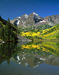The Maroon Bells Peaks and Maroon Lake with autumn Aspen trees, Aspen, Colorado, USA. .  John leads private photo tours throughout Colorado. Year-round Colorado photo tours.