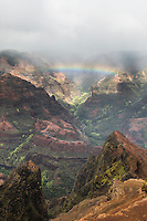 An overview of Wamea Canyon with a rainbow, Kaua'i.