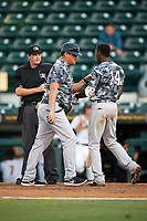Tampa Yankees coach Raul Dominguez (53) steps in between home umpire umpire Derek Thomas and Jorge Mateo (14) during the second game of a doubleheader against the Bradenton Marauders on June 14, 2017 at LECOM Park in Bradenton, Florida.  Mateo was ejected from the game for drawing a line in the batters box with his bat.  Tampa defeated Bradenton 5-1.  (Mike Janes/Four Seam Images)