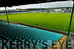 Austin Stacks and Dr Crokes stand for the national anthem  as the stand lien empty before the Kerry Senior football championship at Austin Stack Park on Friday night.