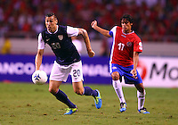 SAN JOSE, COSTA RICA - September 06, 2013: Geoff Cameron (20) of the USA MNT moves the ball away from Yeltsin Tejeda (17) of the Costa Rica MNT during a 2014 World Cup qualifying match at the National Stadium in San Jose on September 6. USA lost 3-1.