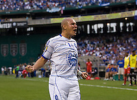 Dennis Alas (14) of El Salvador celebrates his team's goal during the game at RFK Stadium in Washington, DC.  Panama defeated El Salvador on penalty kicks, 5-3, after tying, 1-1,  in regulation time.