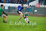 Kilcummin's Cian Lynch attempts to block Laune Rangers Owen Joys effort in the opening round of the County MFL on Monday evening.