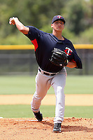 Ricardo Arevalo (18) Pitcher for the GCL Twins delivers a pitch during a game against the GCL Rays on July 16th, 2010 at Charlotte Sports Park in Port Charlotte Florida. The GCL Twins are the the Gulf Coast Rookie League affiliate of the Minnesota Twins. Photo by: Mark LoMoglio/Four Seam Images