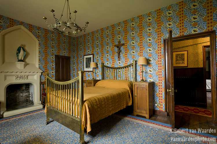 Yellow bed in a bedroom at the Grange in Ramsgate, the United Kingdom. The Grange is a building belonging to the Landmark Trust, a United Kingdom building preservation charity that rescues historic buildings at risk and gives them a new life as places to stay in and experience.