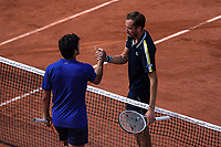 6th June 2021; Roland Garros, Paris France; French Open tennis championships day 8;  Daniil MEDVEDEV ( RUS ) shakes hands with Cristian GARIN ( Chile )