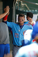 Tennessee Smokies first baseman Dan Vogelbach (21) being congratulated by his teammates after scoring a run during a game against the Jacksonville Suns at Bragan Field on the Baseball Grounds of Jacksonville on June 13, 2015 in Jacksonville, Florida.  Tennessee defeated Jacksonville 12-3. (Robert Gurganus/Four Seam Images)