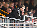 Alloa Manager Paul Hartley watches from the stand.