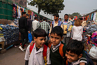 People walk through the street market on Meena Bazar in the Chadni Chowk area of Delhi, India, on Tue., Dec. 11, 2018.