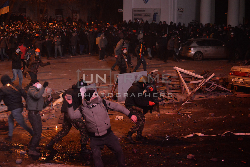 Rioters throw stones and cobblestones against the riot police during the   protest against new draconian law to ban the right to  protest across the country.  Kiev. Ukraine