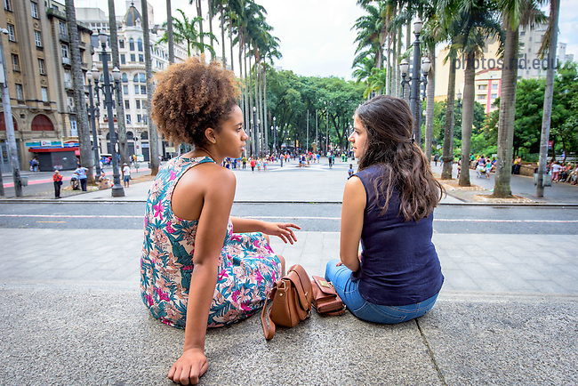 Mar. 12, 2016; Amber Bryan '17  and Monica Barbosa '17 chat on the steps of Catedral da Se de São Paulo in São Paulo, Brazil. Both were spending the Spring 2016 semester studying in São Paulo. (Photo by Matt Cashore/University of Notre Dame)