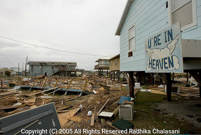 Grand Isle, Louisiana-September 22: A sign expresses an idea  in contrast to the surrounding destruction September 22, 2005 caused by Hurricane Katrina in the vacation destination of  Grand Isle, Louisiana. (Photo By Radhika Chalasani/Getty Images)