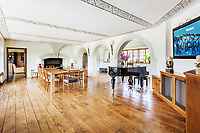 BNPS.co.uk (01202 558833)<br /> Pic: Hamptons/BNPS<br /> <br /> Pictured: A dining room.<br /> <br /> An incredible Arts and Crafts country house with its own vineyard is on the market for offers over £7m.<br /> <br /> The Grade II listed St Joseph's Hall is a striking 111-year-old property that was home to the Bishop of Arundel for 40 years.<br /> <br /> It has a wealth of period features, an indoor swimming pool and seven acres of vineyard with mostly Chardonnay grapes, which the owners sell to a local winery.<br /> <br /> The house in Storrington, West Sussex, has 17 acres of land with beautiful views over the South Downs.