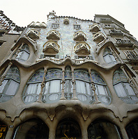 Casa Batllo's undulating exterior is covered with glazed ceramic and broken glass fragments and features irregular windows and flowing sculpted stone work