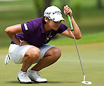CHON BURI, THAILAND - FEBRUARY 17:  Yani Tseng of Chinese Taipei lines up a putt on the 5th hole during day one of the LPGA Thailand at Siam Country Club on February 17, 2011 in Chon Buri, Thailand.  Photo by Victor Fraile / The Power of Sport Images