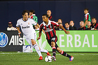 Urby Emanuelson (28) of A. C. Milan is marked by Kaka (8) of Real Madrid. Real Madrid defeated A. C. Milan 5-1 during a 2012 Herbalife World Football Challenge match at Yankee Stadium in New York, NY, on August 8, 2012.